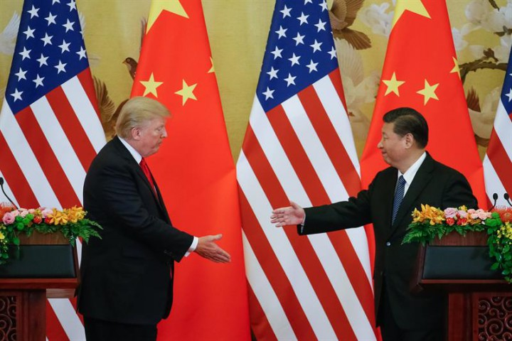 Donald Trump y Xi Jinping, durante un foro bilateral de empresas. Foto: EFE